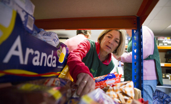 volunteers picking items for food parcel